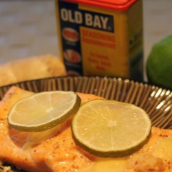Ginger and Lime Salmon Recipe - Fresh ginger and lime slices are arranged atop a salmon fillet and broiled in this refreshing main course perfect for summer evenings.