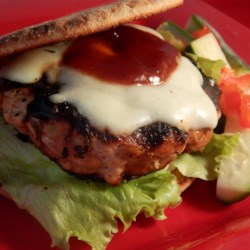 Famous Turkey Burgers Recipe - Even turkey burger skeptics will be singing praises to this famous turkey burger recipe with plenty of flavor from barbeque sauce, chili powder, and green onion. Serve with baked sweet potato chips.