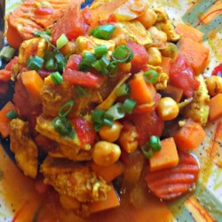 Slow Cooker Chicken Marrakesh Recipe - Chunks of boneless chicken breast simmer for hours with sweet potatoes, garbanzo beans, tomatoes, and North African-inspired spices for a hearty dinner that cooks itself while you do other things.
