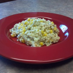 Creamy Corn Couscous Recipe - Couscous, cream-style corn and mozzarella cheese combine in this filling side dish.