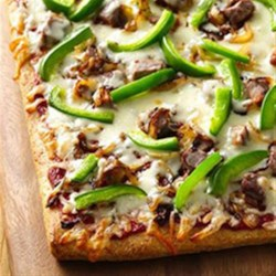 Philly Cheese Steak Pizza from Pillsbury(R) Pizza Crust Recipe - A delicious twist on the traditional roast beef sandwich, with tasty toppings served hot on pizza crust.