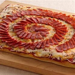 Spiral Pizza Recipe - Treat your family with this spiral pizza that's made using Pillsbury(R) pizza crust and decorated with pepperoni - a delicious dinner that's ready in 30 minutes.