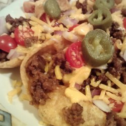 Sloppy Jo-Chos Recipe - I was looking for a way to use up left over sloppy joes after a potluck and came up with this. Hearty and good. It's perfect for football season!