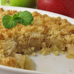 Apple Crisp - Perfect and Easy Recipe - Butter, flour, sugar, cinnamon, and a pinch of salt make a quick and simple topping for fresh sliced apples.