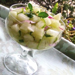 Cucumber Honeydew Salad Recipe - This refreshing salad of cool honeydew melon and cucumbers combined with zippier flavors of mint and lemon is a healthy, easy summertime treat.