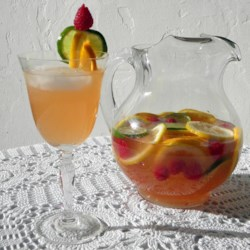 Sunset Sangria  Recipe and Video - This sweet and refreshing punch makes a beautiful centerpiece for your next summer gathering. With sliced citrus fruit, raspberries, and pineapple juice, you may want to make a couple batches--just in case.