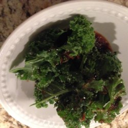 Zesty Kale Recipe - Toasted sesame oil, soy sauce, and garlic give kale a zesty kick in this quick and easy side dish recipe.