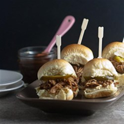 Asian Chicken Sliders Recipe - Apple butter is the secret ingredient in these Asian-inspired chicken sliders with five spice seasoning and soy sauce, cooked to perfection in your slow cooker.