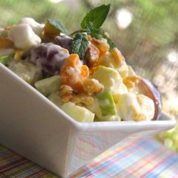 Zesty Apple Salad Recipe - Granny Smith apples, marshmallows, and walnuts are folded together with lemon yogurt for a quick and refreshing summer salad.