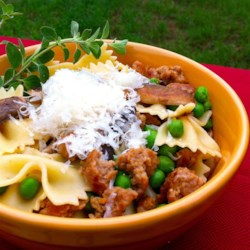 Bow-Tie Pasta with Sausage, Peas, and Mushrooms Recipe - Bow-tie pasta tossed with Italian sausage, portobello mushrooms, and peas is a quick and easy meal for weeknights or dinner party guests.