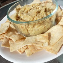Basic Hummus Recipe - A simple blend of garlic, garbanzo beans and sesame seeds is all it takes to whip up a tasty, versatile hummus!