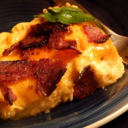 Erik's Cheesy Cauliflower Casserole Recipe - Cauliflower and turkey bacon are baked into a creamy and cheesy casserole using lowfat dairy products for a lighter side dish.