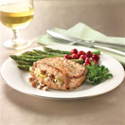 Apple, Goat Cheese and Pecan-Stuffed Pork Chops Recipe - Pork chops marinated in lemon-honey brine are stuffed with a sweet-savory mixture of pecans, apples, and goat cheese, then browned and baked in this gourmet presentation.