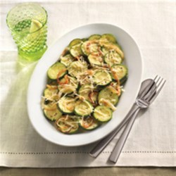 Parmesan Zucchini Recipe - Quickly cooked zucchini and onion slices are tossed with Parmesan cheese for an easy and delicious veggie side dish.