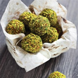 Pistachio Lemon Truffles Recipe - A creamy bite of lemon-flavored goat cheese and cream cheese with a pistachio crust.