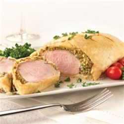 Pork Tenderloin En Croute Recipe - Impress your guests with pork tenderloin wrapped in a sausage filling and a delicate pastry crust.