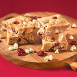 White Chocolate Cranberry Blondies Recipe - A holiday color studded delight.  Serve warm, a la mode for extra fun.