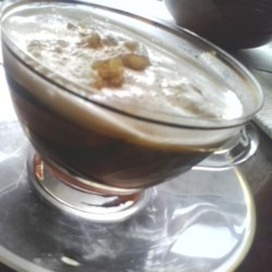 Jamaica Coffee Recipe - An after dinner drink of rum and coffee topped with whipped cream.