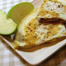 Apple Cinnamon Brie Quesadillas Recipe - Apple cinnamon and brie quesadillas are a sweet treat to serve at brunch or as a dessert and get the kids' stamp of approval.