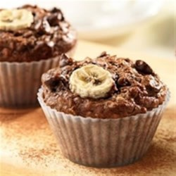 Cocoa Banana Bran Muffins Recipe - Banana, chocolate chips and cocoa star in this delicious recipe . . . no one will guess there's a kick of fibre in each muffin!