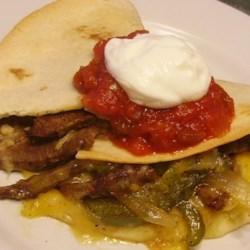 Fajita Quesadillas Recipe - Combine the ingredients for fajitas together with quesadillas to create steak fajita quesadillas for a quick and easy dinner.