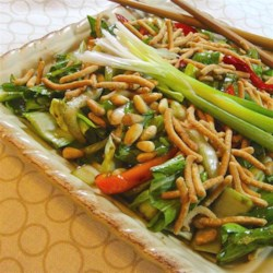 Asian Bok Choy Salad Recipe - Bok choy and green onions are topped with pine nuts and crunchy noodles, and served with a mildly sweet dressing.