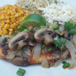 Mushroom, Cheese, and Haddock Bake Recipe - Haddock fillets are topped with a green onion, mushroom, and Colby-Monterey Jack cheese mixture and baked until melty.