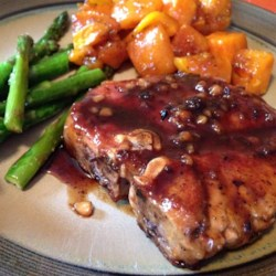 Pork Chops with Apple Cider Glaze Recipe - Pork chops with a glossy apple cider glaze is really easy, and while there's no starch or extra butter involved, it reduces quickly to a thick, rich, sweet-tart apple syrup.