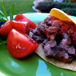 Carne Asada Tacos or Al Pastor Tacos Recipe - The marinade for this traditional Mexico City-style taco is spiced, but not spicy. Use flank steak or any other cut of meat you like.