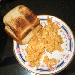 Savory Scrambled Eggs Recipe - My sister-in-law used to make this for breakfast, it has taste and zing, not bland like your regular scrambled eggs, and easy to prepare too.  Suitable for those who likes a bit of spice in their breakfast! Serve with toast and baked beans.