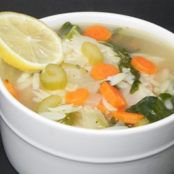 Lemon Chicken Orzo Soup Recipe - Inspired by Panera Bread's version, this soup delivers on flavor. Tender chicken in a lemony broth with orzo pasta, carrots, onions, celery, and baby spinach.