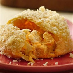 Buffalo Chicken Crescent Puffs Recipe - A spicy chicken and cheese filling mixture is baked into flaky Pillsbury(R) refrigerated crescent rounds in this easy appetizer that will disappear fast!