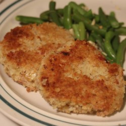 Ham Cake-ettes Recipe - Tasty ham and potato patties with green onion and Dijon mustard are rolled into panko bread crumbs and fried until golden brown. The delicious little cakes are a great way to use up post-holiday leftovers.
