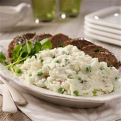 Baby Red Mashed Potatoes and Peas with Spring Meatloaf Recipe - A tasty meatloaf made of your choice of lamb or beef is served with mashed potatoes flavored with green onions and fresh peas for a colorful meal perfect for springtime.