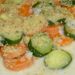 Carrot Zucchini Casserole Recipe - Tender carrots and zucchini get a little zing from prepared horseradish and mayonnaise in this creamy baked side dish.