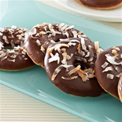 Dark Chocolate Glazed Coconut Ringlets Recipe - Ring-shaped cookies are dipped in dark chocolate glaze and sprinkled with toasted coconut for a unique cookie for the holidays or everyday.