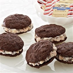 Peppermint Chocolate Sandwich Cookies Recipe - Handcrafted chocolate cookies are sandwiched around a filling of creamy peppermint icing for a beautiful holiday treat.