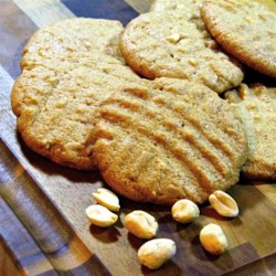 Light and Soft Peanut Butter Cookies Recipe - Using reduced-fat peanut butter keeps this classic cookie from feeling too greasy. An extra egg white gives it a lighter texture.