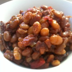 Slow Cooker Baked Beans Recipe - These slow cooker baked beans and ham go with all your favorite foods and are ready just in time for dinner.
