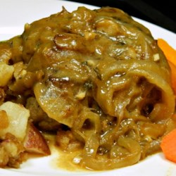 Chef John's Smothered Pork Chops  Recipe and Video - Poultry seasoning is the special secret spice that gives a flavor twist to comforting home-style pork chops simmered in rich onion gravy.