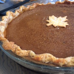 Mom's Pumpkin Pie Recipe - Pumpkin puree is blended with white and brown sugars, milk, cream, and pinches of cinnamon, nutmeg, ginger, and cloves. Altogether, they make a rich and sensational pumpkin pie filling that bakes up perfectly for the holidays.
