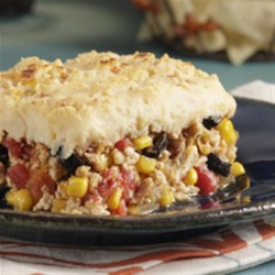 Idahoan Mexican Casserole Recipe - As if this recipe didn't have enough kick, topping it with Idahoan Bacon & Cheddar Chipotle Flavored Mashed Potatoes definitely takes it up a notch.
