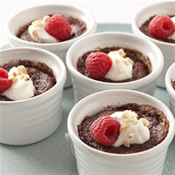 Mini Dark Chocolate Pudding Cakes Recipe - When these mini pudding cakes bake, the chocolate cake layer on the bottom rises to the top and leaves a rich, pudding layer beneath for a delicious, decadent dessert.