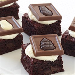 Red Velvet Squares Recipe - Rich, dark chocolate brownie squares are topped with cream cheese frosting and Ghirardelli® Holiday Impressions.