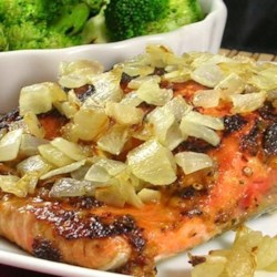 Spicy Salmon with Caramelized Onions Recipe - Salmon fillets are marinated with a spice paste and finished with caramelized onions in this quick and easy dish.