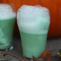 Slime Punch Recipe - Halloween is supposed to be horrific and gross, but this punch is spooky and sweet.
