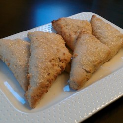 Cardamom Biscuits Recipe - Triangle-shaped biscuits are flavored with cardamom and have a crunch of raw sugar on top.
