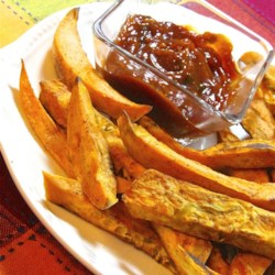 Easy Sweet Potato Fries with Curry Ketchup Recipe - Baked sweet potato fries are served with curry-flavored ketchup for an easy side dish with a gourmet touch.