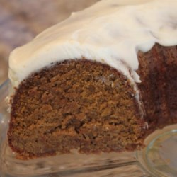 Pumpkin Spice Cake I Recipe - This pumpkin spice cake is studded with chopped pecans and baked in a tube pan or Bundt pan. Glaze with cream cheese frosting.