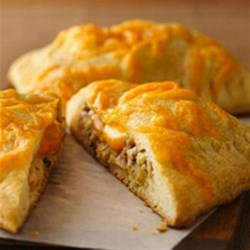 Green Chile and Tuna Crescent Melts Recipe - Dinner ready in 25 minutes! Serve these savory crescents made using Pillsbury(R) dinner rolls filled with tuna salad mixture, cheese and Old El Paso(R) chiles.